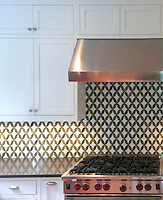 Audrey, a stone water jet mosaic,  shown in Thassos and Chartreuse is part of the Ann Sacks Beau Monde collection sold exclusively at www.annsacks.com