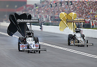 Jun 20, 2015; Bristol, TN, USA; NHRA top fuel driver Larry Dixon (left) slows down alongside Tony Schumacher during qualifying for the Thunder Valley Nationals at Bristol Dragway. Mandatory Credit: Mark J. Rebilas-