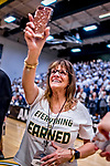 16 March 2019: University of Vermont Dance Team Coach Lynn Bessette takes photos during the post-game celebrations of the UVM Men's Basketball Team over the UMBC Retrievers, in the America East Championship Game at Patrick Gymnasium in Burlington, Vermont. The Catamounts defeated the Retrievers 66-49 to take the AE Championship for the 2018/2019 NCAA Men's Basketball season. Mandatory Credit: Ed Wolfstein Photo *** RAW (NEF) Image File Available ***