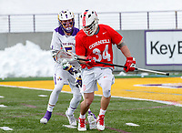 University at Albany Men's Lacrosse defeats Cornell 11-9 on Mar 4 at Casey Stadium.  Jake Pulver (#34) chases a loose ball.