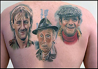BNPS.co.uk (01202 558833)<br /> Pic:    DeanPaine/BNPS<br /> <br /> Work in progress...it took 50 hours in total to complete the design.<br /> <br /> Mon Dieu! An Only Fools and Horses superfan has been to 'Hull and Back' to pay tribute to the classic BBC sitcom.<br /> <br /> Dean Paine sat through 50 hours of agony to have the show's main characters tattooed on his back.<br /> <br /> Dean designed the brilliant body art himself using colour photos of Del Boy, Rodney, Grandad, Uncle Albert, Boycie and Trigger.<br /> <br /> He also included the Only Fools and Horses emblem and Del's famous yellow three wheeled van.