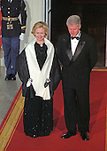 United States President Bill Clinton and first lady Hillary Rodham Clinton await the arrival of Prime Minister Keizo Obuchi and his wife, Chizuko Ono, of Japan on the North Portico of the White House for an Official Dinner in their honor at the White House in Washington, D.C. on May 3, 1999.  <br /> Credit: Ron Sachs / CNP