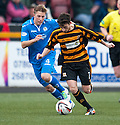 Alloa's Kevin Cawley tries to get away from Queen of the South's Kevin Dzierzawski.