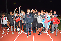 RICK PECK/SPECIAL TO MCDONALD COUNTY PRESS The McDonald County High School boys' track team completes a victory lap after winning the school's first conference team title at last week's conference track meet.