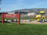 Playground at Wiseman Airport Park, Petaluma Municipal Airport, Petaluma, Sonoma County, California. The Petaluma Area Pilot's Association hangar and Sonoma Mountain are in the background.
