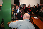 Nevada Lt. Gov. Brian Krolick watches his daughter Ellie, 11, mint a medallion with the second design in a four-part series of Sesquicentennial medallions at the Nevada State Museum, in Carson City, Nev., on Wednesday, Feb. 26, 2014. <br /> Photo by Cathleen Allison/Nevada Photo Source