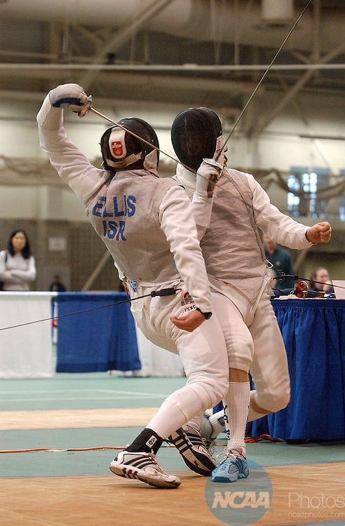 28 MAR 2004: Boaz Ellis (left) of Ohio State University tries a behind the back attack against Cory Werk (right) of Yale University during the Men's Foil event at the 2004 NCAA Division 1 Fencing Championships held at Gosman Athletic Center on the campus of Brandies University in Waltham, MA. Ellis placed first in the competition to win the national title. Jim Mahoney/NCAA Photos