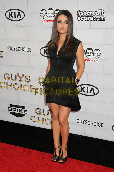 "Mila Kunis.Spike TV's 6th Annual ""Guys Choice"" Awards held at Sony Pictures Studios, Culver City, California, USA, .2nd June 2012..full length black zip up sleeveless dress sandals  t-bar open toe shoes hands in pockets cuff silver bracelet .CAP/ADM/BP.©Byron Purvis/AdMedia/Capital Pictures."