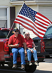 Sam Kohler (left) and his wife Susan Kohler of Waterloo wait for the procession to arrive in Waterloo. They were parked across the street from Waterloo City Hall where hundreds of residents had come to pay respects to fallen ISP Trooper Nick Hopkins. Dozens of police departments joined in the procession from St. Louis to Waterloo for slain Illinois State Police Trooper Nick Hopkins on Monday August 26, 2019. <br /> Photo by Tim Vizer