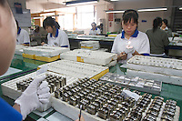 Workers test lighters in the factory of Zhejiang Tiger Lighter Co Ltd. Wenzhou, China. Mr Zhou Dahu, spent 16 years building the Tiger Lighter empire in Wenzhou, Zhejiang, where more than 80 per cent of the world's lighters are made. Wenzhou is home to China's largest pool of private floating capital - 600 billion yuan US$87.8 billion) by some estimates - and it has long been hailed as a symbol of the country's private economy..28 Oct 2008