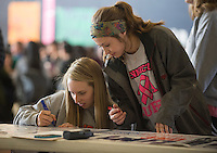"NWA Democrat-Gazette/J.T. WAMPLER Sydney Cinnamon (left) and Hannah Martin sign a banner Monday Feb. 13, 2017 at Rogers Heritage High School. The banner reads: ""Heritage United: We are one, divided by none."" Students were encouraged to sign their name and add a message on what unites them as opposed to what divides them."