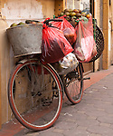 Bicycle 06 - Bags of oranges on a bicycle leaning against a wall in Hang Trong St, Hanoi Old Quarter, Vietnam