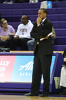 SEATTLE, WA - DECEMBER 18: Savannah State head coach Cedric Baker watches his team from the bench against Washington..  Washington won 87-36 over Savannah State at Alaska Airlines Arena in Seattle, WA.