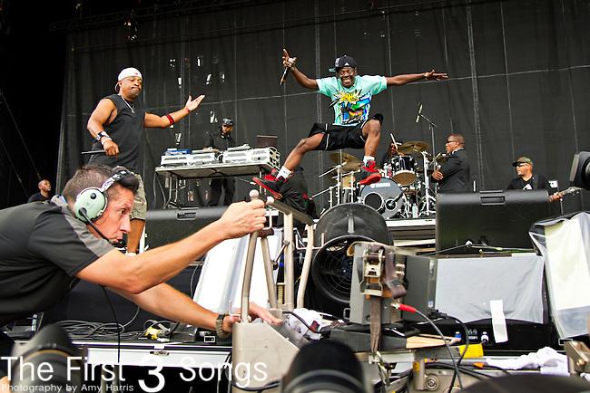 Flavor Flav (born William Jonathan Drayton, Jr.) of Public Enemy performs during the 2013 Budweiser Made in America Festival in Philadelphia, Pennsylvania.