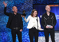 "Phil Hanseroth, from left, Brandi Carlile and Tim Hanseroth accept the award for best Americana album for ""By the Way, I Forgive You"" at the 61st annual Grammy Awards on Sunday, Feb. 10, 2019, in Los Angeles. (Photo by Matt Sayles/Invision/AP)"