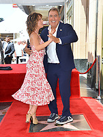 LOS ANGELES, CA. July 24, 2019: Kenny Ortega & Jennifer Grey at the Hollywood Walk of Fame Star Ceremony honoring Kenny Ortega.<br /> Pictures: Paul Smith/Featureflash