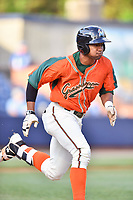 Greensboro Grasshoppers third baseman James Nelson (20) runs to first base during a game against the Asheville Tourists at McCormick Field on April 27, 2017 in Asheville, North Carolina. The Tourists defeated the Grasshoppers 8-5. (Tony Farlow/Four Seam Images)