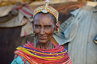 KENYA Marsabit, Samburu pastoral tribe, portarit of woman with traditional necklace and cap / KENIA, Marsabit, Samburu Dorf Hargura, Portraet einer Samburu Frau mit traditionellem Halsschmuck