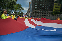NEW YORK, NY - JUNE 11:  Participants hold a big Puerto Rico's flag during  the NYC's 60th annual Puerto Rico Day parade led by mayor Bill de Blasio on June 11, 2017 in New York City. (Photo by Maite H. Mateo/VIEWpress/Corbis via Getty Images)
