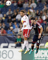 New York Red Bulls substitute midfielder Brandon Barklage (25) and New England Revolution substitute defender Stephen McCarthy (26) battle for head ball. Despite a red-card man advantage, in a Major League Soccer (MLS) match, the New England Revolution tied New York Red Bulls, 1-1, at Gillette Stadium on September 22, 2012.