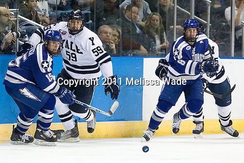 Sean Bertsch (Air Force - 15), Chad Ziegler (Yale - 59), Scott Kozlak (Air Force - 8) - The Yale University Bulldogs defeated the Air Force Academy Falcons 2-1 (OT) in their East Regional Semi-Final matchup on Friday, March 25, 2011, at Webster Bank Arena at Harbor Yard in Bridgeport, Connecticut.
