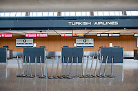 The morning hours are quiet at Turkish Airlines, at the international terminal at Dulles International Airport in Dulles, Va., Monday, March16, 2020. Some people are taking the precaution of wearing face masks as they arrive to be greeted by family and or friends. Credit: Rod Lamkey / CNP/AdMedia