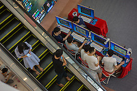 Chinese youths take part in a computer game contest at a shopping centre in Dongguan, Guangdong province, China, August 2016.