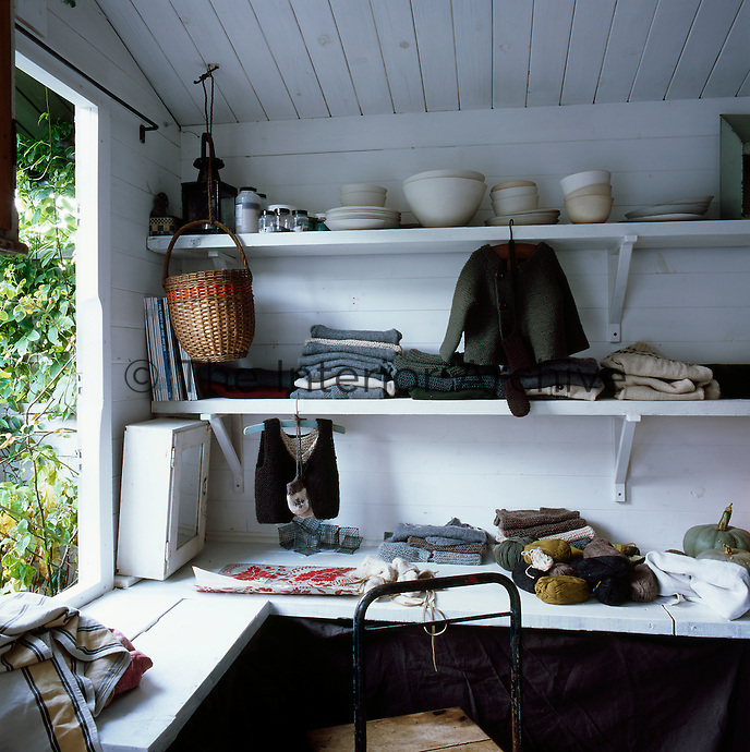 Anna Phillips' studio is housed in a timber shed in the garden, from where she runs her knitwear business Hambro & Miller. The studio doubles as a pottery shed and home-made ceramics sit on the top shelf.