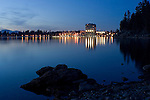 The world famous Couer D Alene resort and downtown Coeur D Alene, Idaho reflected in the waters of Lake Coeur D Alene at night.