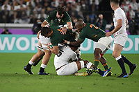 1st November 2019, Yokohama, Japan;  Eben Etzebeth of South Africa tackled by Courtney Lawes of England during the 2019 Rugby World Cup Final match between England and South Africa at the International Stadium Yokohama in Yokohama, Kanagawa, Japan on November 2, 2019.
