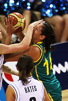 Tall Ferns guard Toni Edmondson fouls Rohanee Cox during the International women's basketball match between NZ Tall Ferns and Australian Opals at Te Rauparaha Stadium, Porirua, Wellington, New Zealand on Monday 31 August 2009. Photo: Dave Lintott / lintottphoto.co.nz
