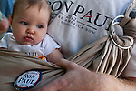 Lucy DeVries, age six months, attends the Iowa Republican Straw Poll with her father, who supports Republican presidential hopeful Ron Paul, on Saturday, August 13, 2011 in Ames, IA.