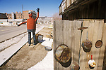 A rust-colored muffler man sculpture with raised arm in greeting along U.S. Highway 95, Goldfield, Nev.