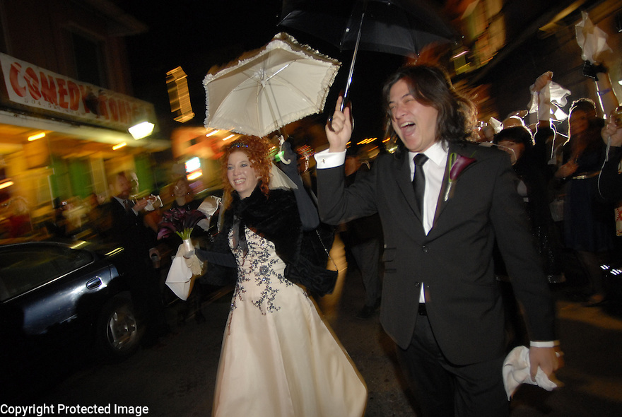 Sean Yseult and Chris Lee secondline through the French Quarter after their wedding in New Orleans, Saturday, Jan. 12, 2008.