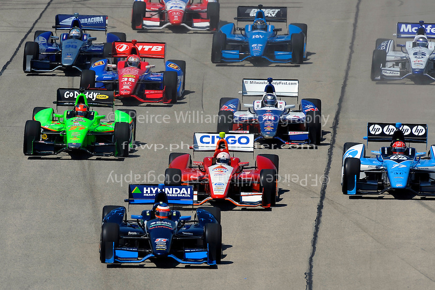 Rubens Barrichello (#8) leads E. J. Viso (#5), Simon Pagenaud (#77), James Hinchcliffe (#27), Marco Andretti (#26), `38, Alex Tagliani (#98), Katherine Legge (#6), Josef Newgarden (#67) and James Jakes (#19).