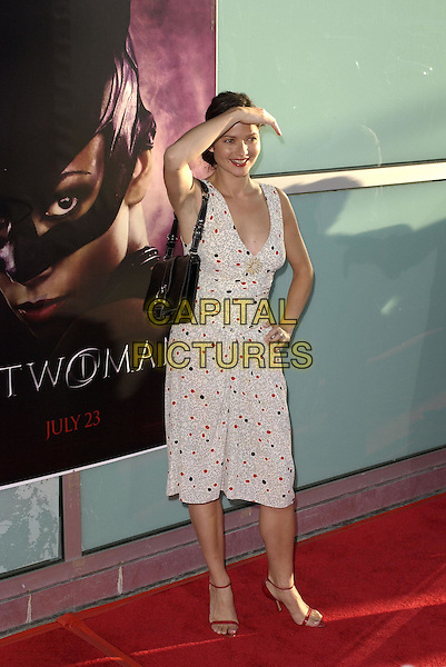 Jill Hennessy .Warner Brothers' World Premiere of Catwoman held at The Arclight Cinerama Dome Theatre in Hollywood, California on July 19,2004..full length white patterned dress black and red polka dots.Ref: DVS.www.capitalpictures.com.sales@capitalpictures.com.©Capital Pictures.