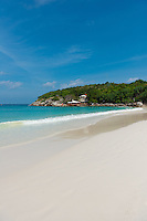 Perfect shore line of white sand on Raya island, near Phuket, Thailand