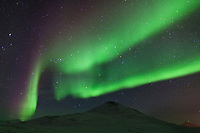 Aurora borealis, (northern lights), over the Brooks range mountains, arctic, Alaska.