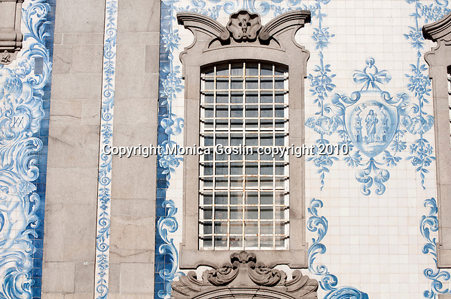 Azulejos on the outside wall of the Carmo Church in Porto, Portugal. Blue and white tile decorations on the Carmo Church in Porto, Portugal.