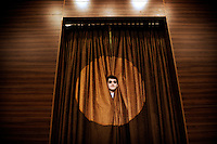 Baris peeks out from behind a theatre curtain. .Baris dreams of becoming a famous actor. He lives in Istanbul and is active at his local theatre. .
