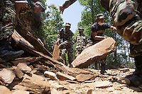 Nepali army clears a road in Sindhupalchok, outstrike of Kathmandu, Nepal. May 1, 2015