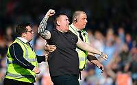 A spectator is escorted off the pitch by stewards after the final whistle<br /> <br /> Photographer Chris Vaughan/CameraSport<br /> <br /> The EFL Sky Bet League One - Scunthorpe United v Bolton Wanderers - Saturday 8th April 2017 - Glanford Park - Scunthorpe<br /> <br /> World Copyright &copy; 2017 CameraSport. All rights reserved. 43 Linden Ave. Countesthorpe. Leicester. England. LE8 5PG - Tel: +44 (0) 116 277 4147 - admin@camerasport.com - www.camerasport.com