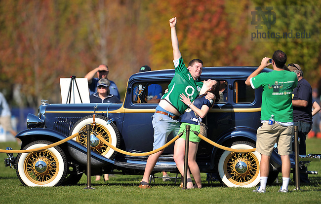 Oct. 8, 2011; Visitors to the Irish Green have their picture taken next to the 1931 Rockne automobile.  Rockne was a subsidiary of Studebaker named after the legendary Irish coach...Photo by Matt Cashore/University of Notre Dame