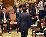 July 15, 2015, Tokyo, Japan - Japans Prime Minister Shinzo Abe, back to camera, leaves a Diet lower house special committee on national security shortly before voting on the government-sponsored security related bills in Tokyo on Wednesday, July 15, 2015. Amid roars and cries of protest from opposition party lawmakers, the committee voted to approve the bills with the support of the ruling Liberal Democratic Party and its junior coalition partner Komeito. The bills will be put to a vote in a Diet plenary session as early as July 16, after which it will be sent to the upper house. The bills, when enacted, will allow Japan to exercise its right to collective self-defense.  (Photo by Natsuki Sakai/AFLO) AYF -mis-