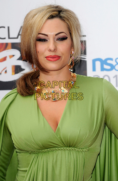 IMMODESTY BLAIZE .Attending the Classical BRIT Awards at the Royal Albert Hall in London, England, UK, May 13th, 2010. .Brits arrivals portrait headshot green gold necklace red lipstick make-up.CAP/CJ.©Chris Joseph/Capital Pictures.