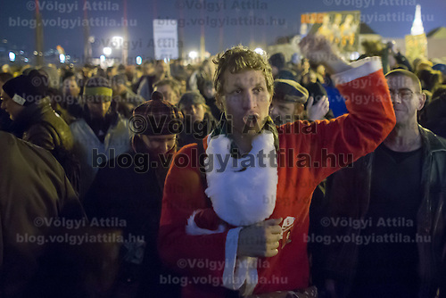 Man dressed in a Santa Claus dress attends a protest against government corruption in Budapest, Hungary on December 04, 2014. ATTILA VOLGYI