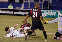 The Rapids' Jordan Cila splits the MetroStars defense of  Craig Ziadie and Eddie Pope to score on goalkeeper Jonny Walker for his second goal of the game in the 89 minute. The Colorado Rapids defeated the NY/NJ MetroStars 3 to 2 at Giant's Stadium, East Rutherford, NJ, on June 30, 2004.