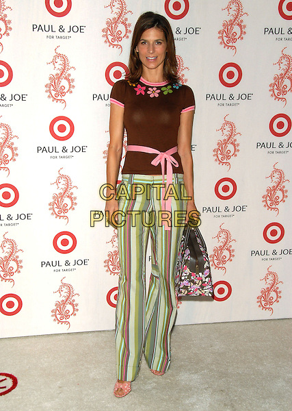 PERREY REEVES.Sophie Albou's Paul & Joe Collection for The Opening of Target Temporary Boutique on Melrose in Beverly Hills, California, USA..July 27th, 2006.Ref: DVS.full length brown top pink ribbon belt green striped stripes trousers.www.capitalpictures.com.sales@capitalpictures.com.©Debbie VanStory/Capital Pictures