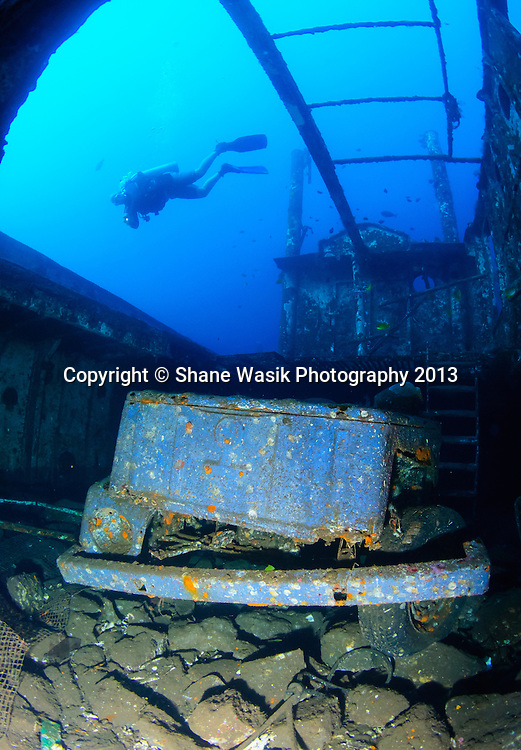 Diver swims about the VW car in the hold