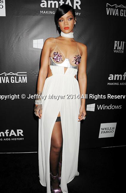 HOLLYWOOD, CA- OCTOBER 29: Recording artist Rihanna attends amfAR LA Inspiration Gala honoring Tom Ford at Milk Studios on October 29, 2014 in Hollywood, California.
